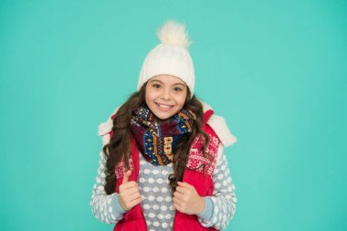 kid warm knitwear. Trendy and stylish. Portrait of smiling girl hipster. Youth street fashion. Winter fun. feeling cold this season. Dress in layers and wear hat. Stay active. it is cold outside