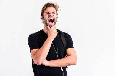 sleepy man. Enjoying music. new technology in modern life. sexy muscular man listen music. man listen new song isolated on white. unshaven man in blue tooth technology earphones. moder life concept