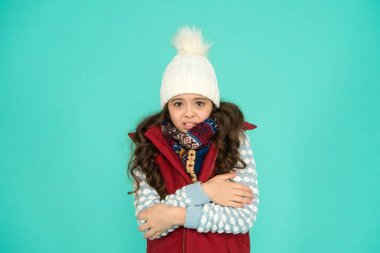 Winter flu. feeling cold this season. Dress in layers and wear hat. Stay active. it is cold outside. kid warm knitwear. winter vibes. Portrait of girl hipster. Youth street fashion. Feeling cozy