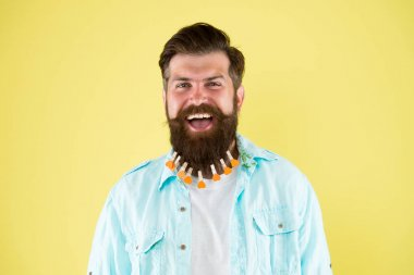 Man lot clothespin on beard. Brutal hipster with clothespins hearts. All about design. Love grooming. Love myself. Nourish hair with love. Valentines day. Barbershop concept. Hairdresser salon