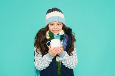 best hand warmer. winter vibes. happy girl hipster. kid winter fashion. feeling good any weather. Stay active this season. kid warm knitwear. child hot tea cup. Have warming drink. ideas for warming