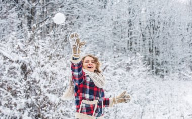 Real feelings. winter and people concept. having snowball fight. happy woman play snowball outdoor. girl in trendy winter jacket. girl wear mittens keep hands warm. good mood any weather