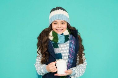 Have warming drink. more ideas for warming. winter vibes. happy girl hipster. kid winter fashion. feeling good any weather. Stay active this season. kid warm knitwear. child hot tea cup