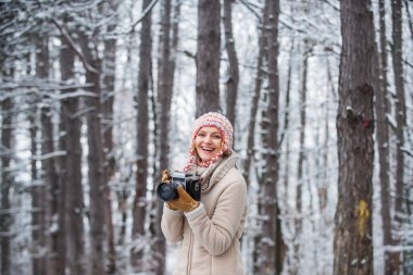 admiring winter mountain landscape. Happy tourist woman in winter. professional photographer outdoor in winter. woman use vintage camera. hobby time outdoor in winter day. Feeling frosty