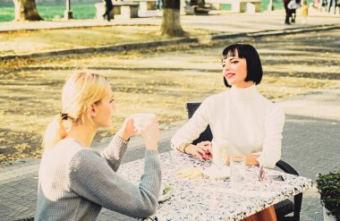 Friendship meeting. Female friendship. Trustful communication. Girls friends drink coffee and talk. Conversation of two women cafe terrace. True friendship friendly close relations. Sharing thoughts