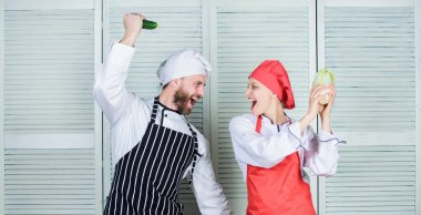 Chefs of organic food restaurant. Cooking healthy food. Fresh vegetarian healthy food recipe. Join healthy lifestyle. Fresh vegetables. Vegetarian family. Woman and bearded man cooking together