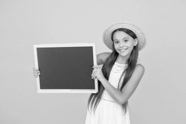 Do not forget shop this items for vacation. Girl hold chalkboard copy space. Useful information. Summer clubs for kids. Child in straw hat informing summer events. Ideas for leisure. Summer travel