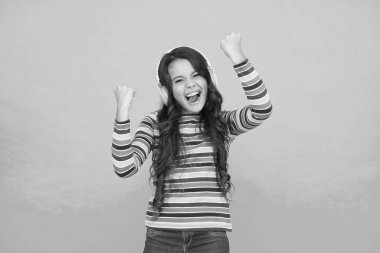 Melody to cheer up. Energetic rhythm concept. Good track improves mood. Happy small girl listen music. Little child enjoy song playing in headphones. Happy face. Music brings happy emotions