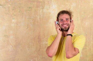 Cheerful dj listening songs via earphones. European man have fun time.