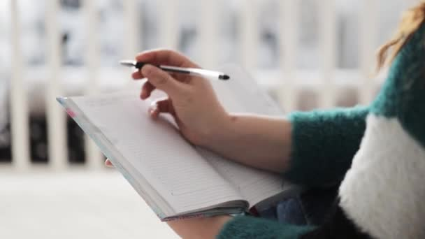 Closeup Of Woman Writing In Notebook In Bed, In Morning.