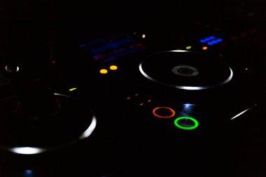 close up of dj mixer lighting at club
