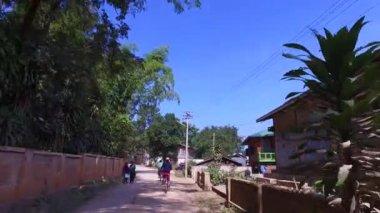 Ride with bicycle through fishing village, Myanmar