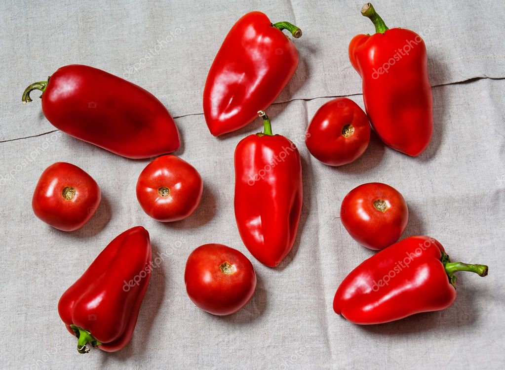 Tomatoes And Sweet Peppers On Gray Tablecloth. Top View U2014 Stock Photo