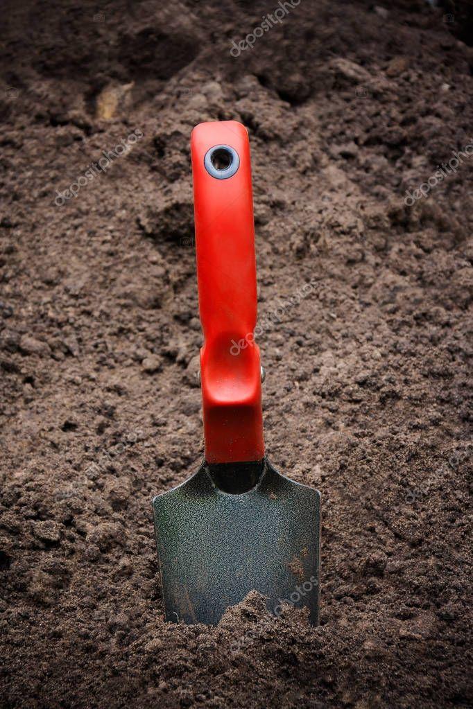 Garden shovel  in the dirt