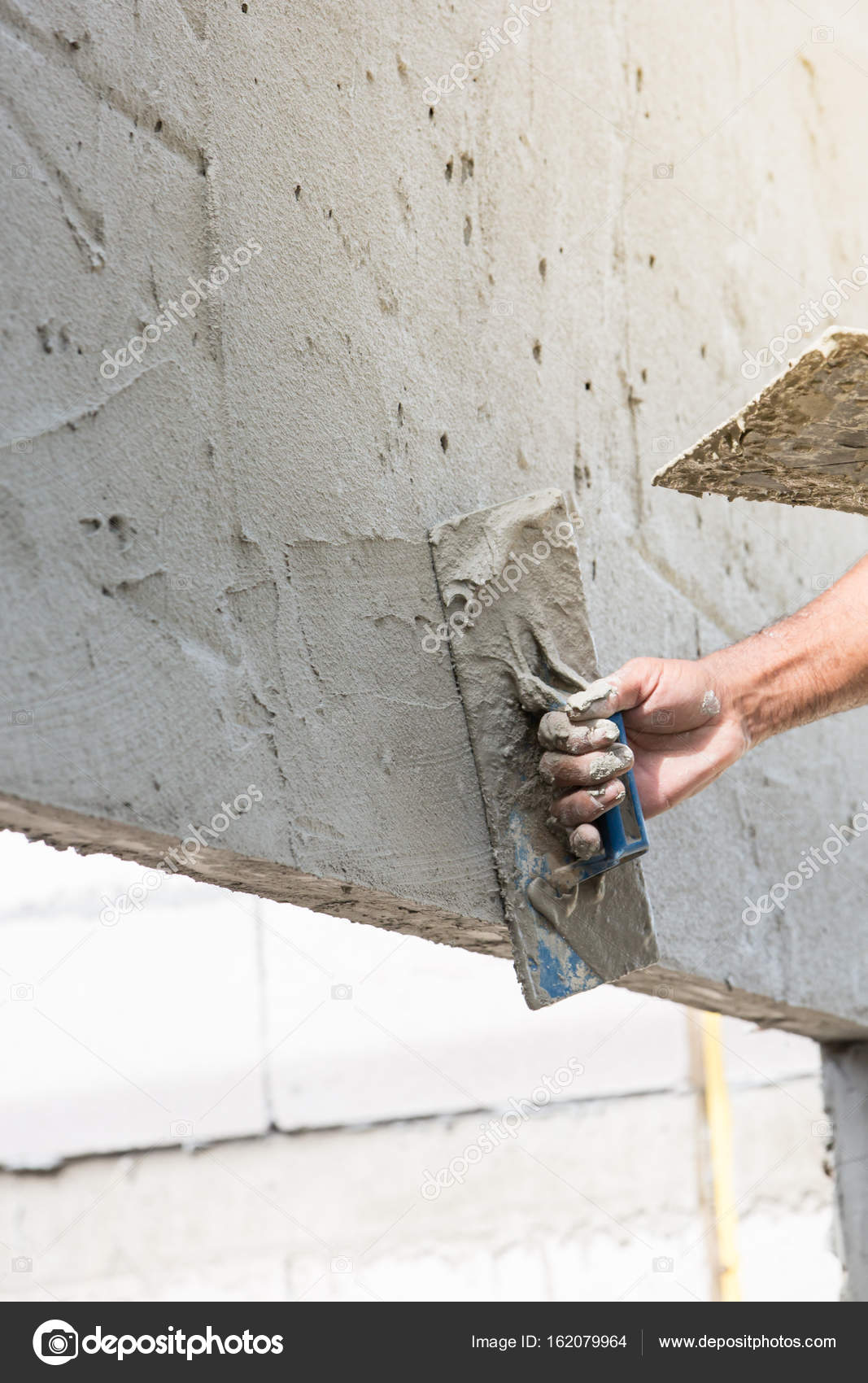 Construction mason plastering the concrete to build wall — Stock