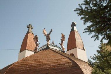 Cskszereda Miercurea Ciuc, April 21, 2018 Millennium Catholic Church. The 5.7 m high copper angel statues depict the great angels of St. Michael, Gabriel, Rafael and Uriel.