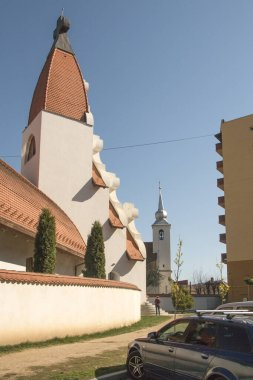 Cskszereda Miercurea Ciuc, April 21, 2018 The new Millennium Church and the Old Church of the Holy Cross next to each other.
