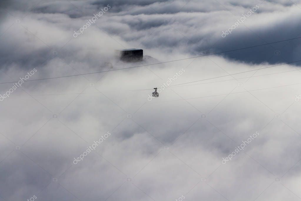 Ski lift in St. Anton am Arlberg, Austria, above the clouds