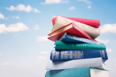 stack of Books on sky background