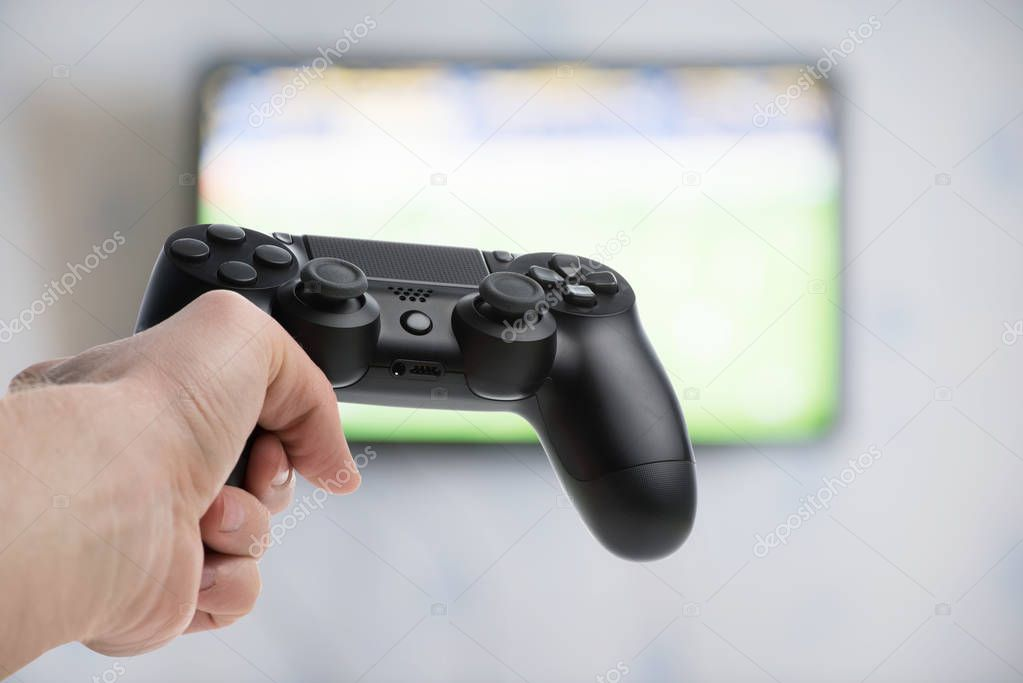 Gamepad in manle  hand
