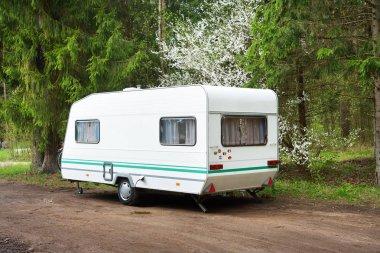 Caravan trailer on a forest road