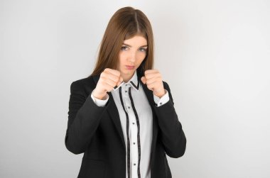 Business and advertising theme: beautiful young girl with freckles on her face in a black jacket and white shirt showing gestures isolated on a white background in the studio, a bank manager
