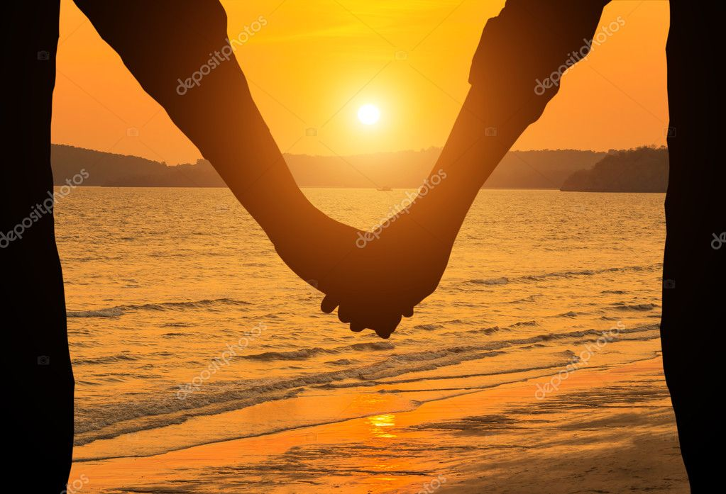 silhouette couple holding hands on tropical beach in sunset stock photo 127755346