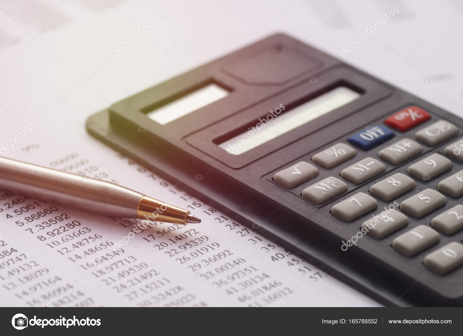 calculator and pen on paper finance account and capital stock