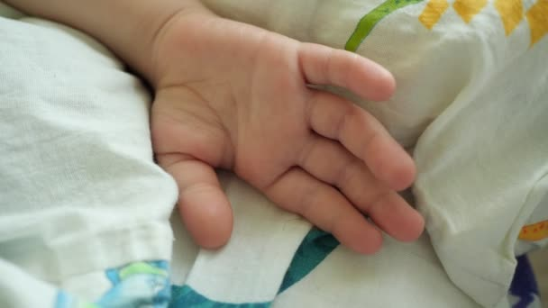 Close-up. The hand of the sleeping boy of preschool age.