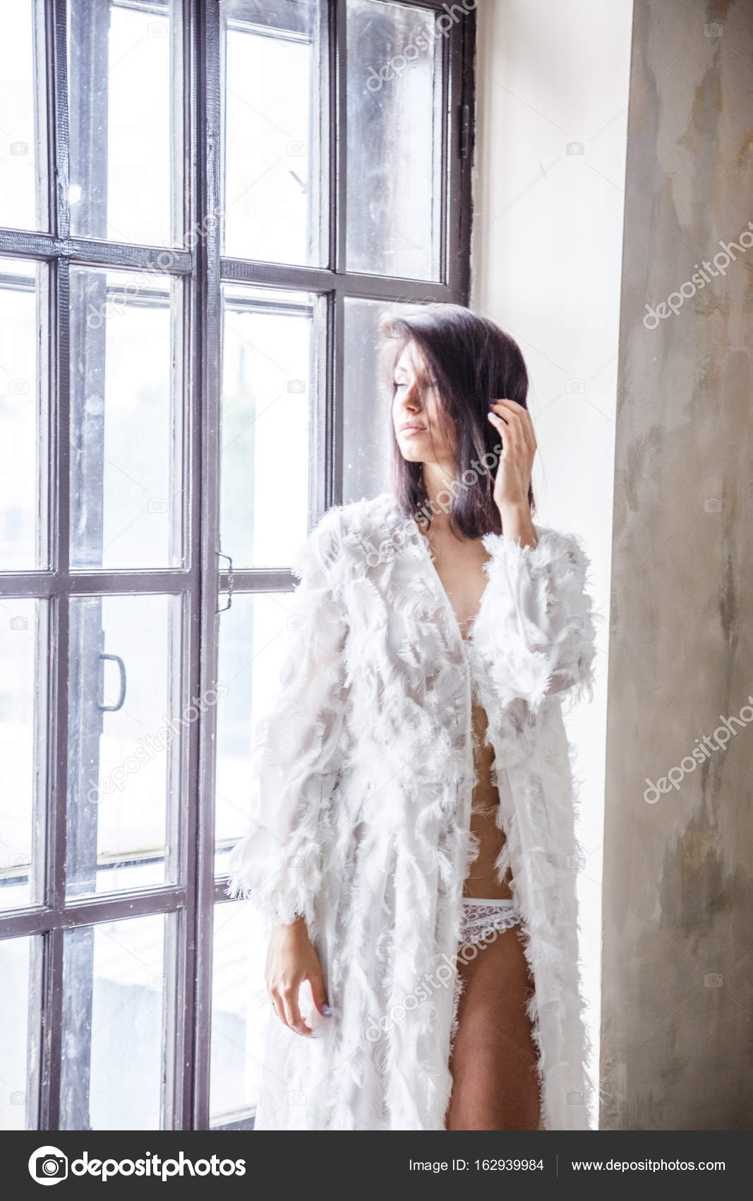 woman in dressing gown posing — Stock Photo © schummyone #162939984
