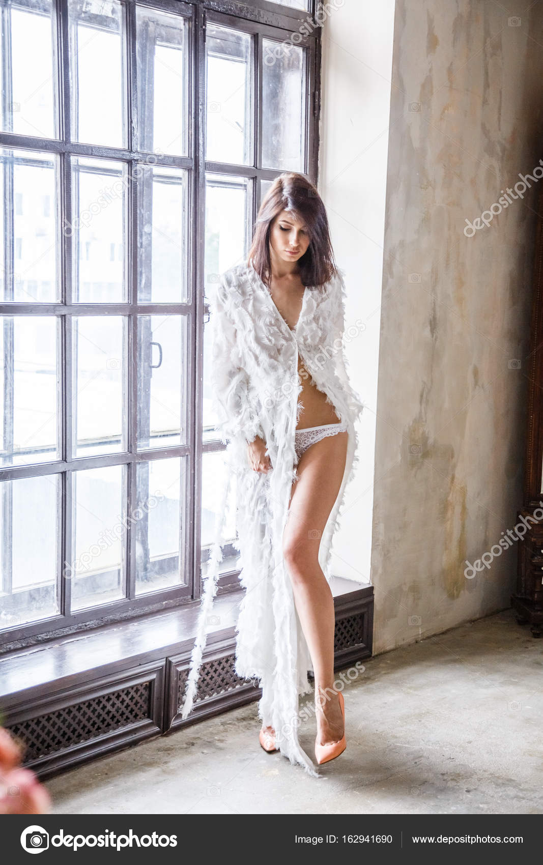 woman in dressing gown posing — Stock Photo © schummyone #162941690