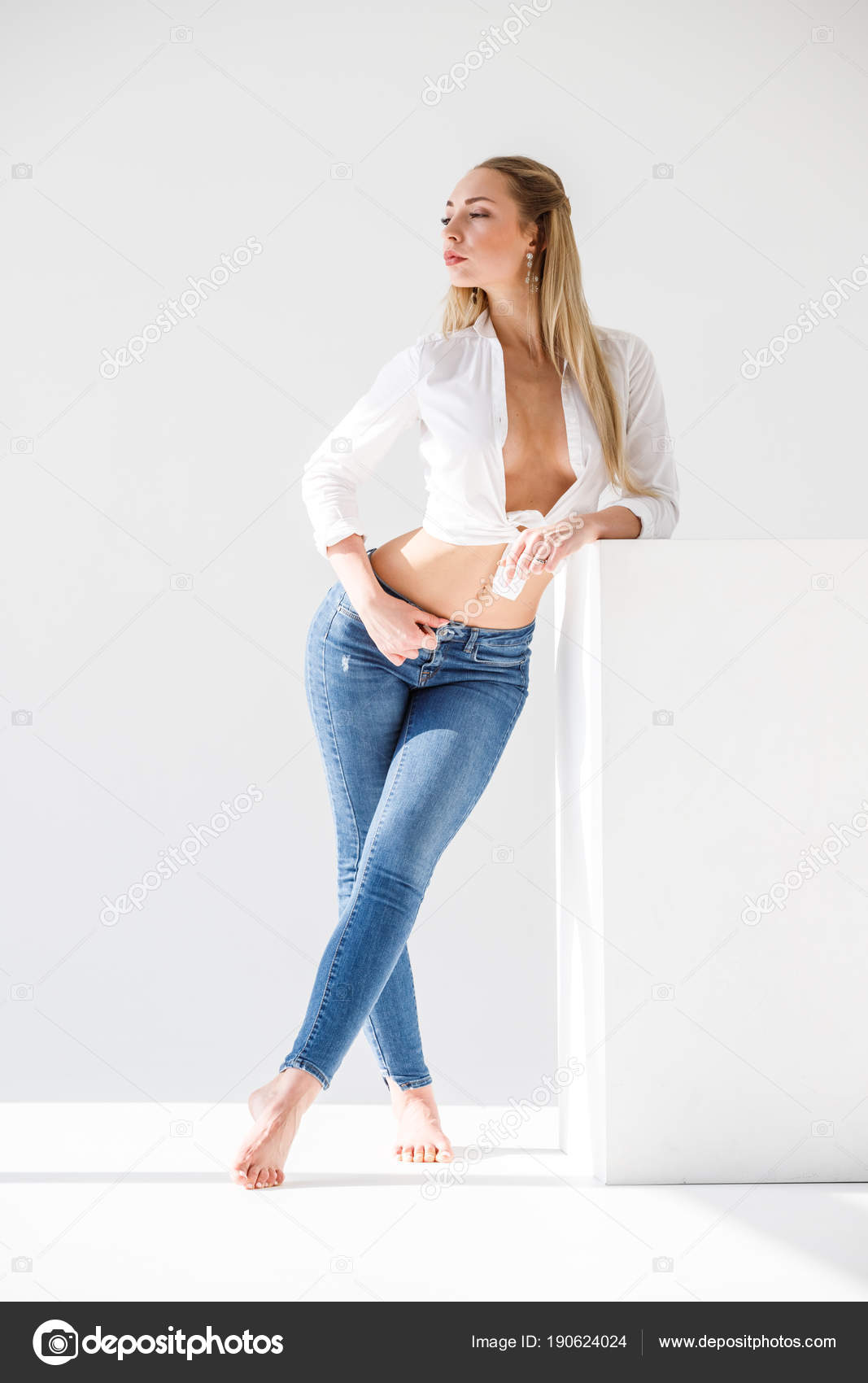 Sexy girl standing barefoot consider