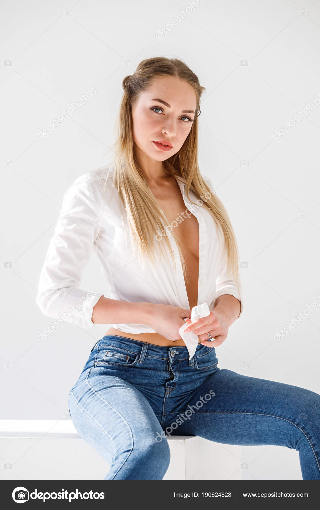 Infinitely possible sexy blonde posing in jeans
