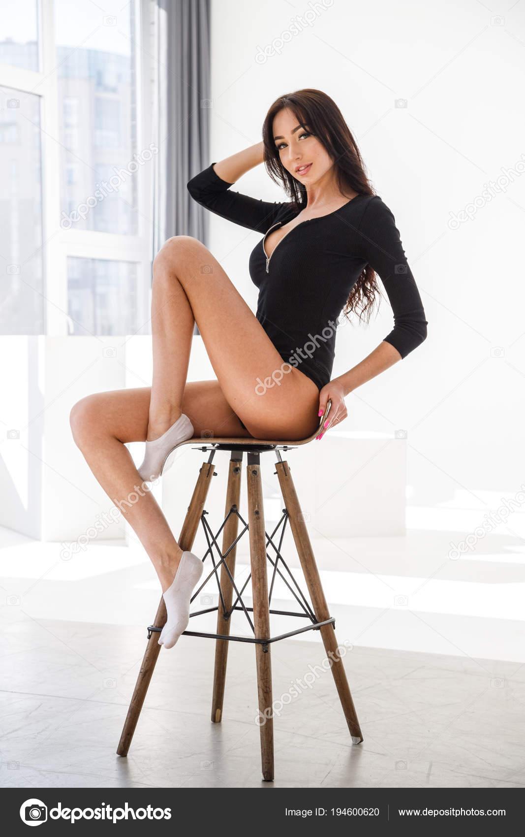 87d6278c4fc Studio Portrait Young Brunette Girl Wearing Sexy Black Lingerie Sitting —  Stock Photo