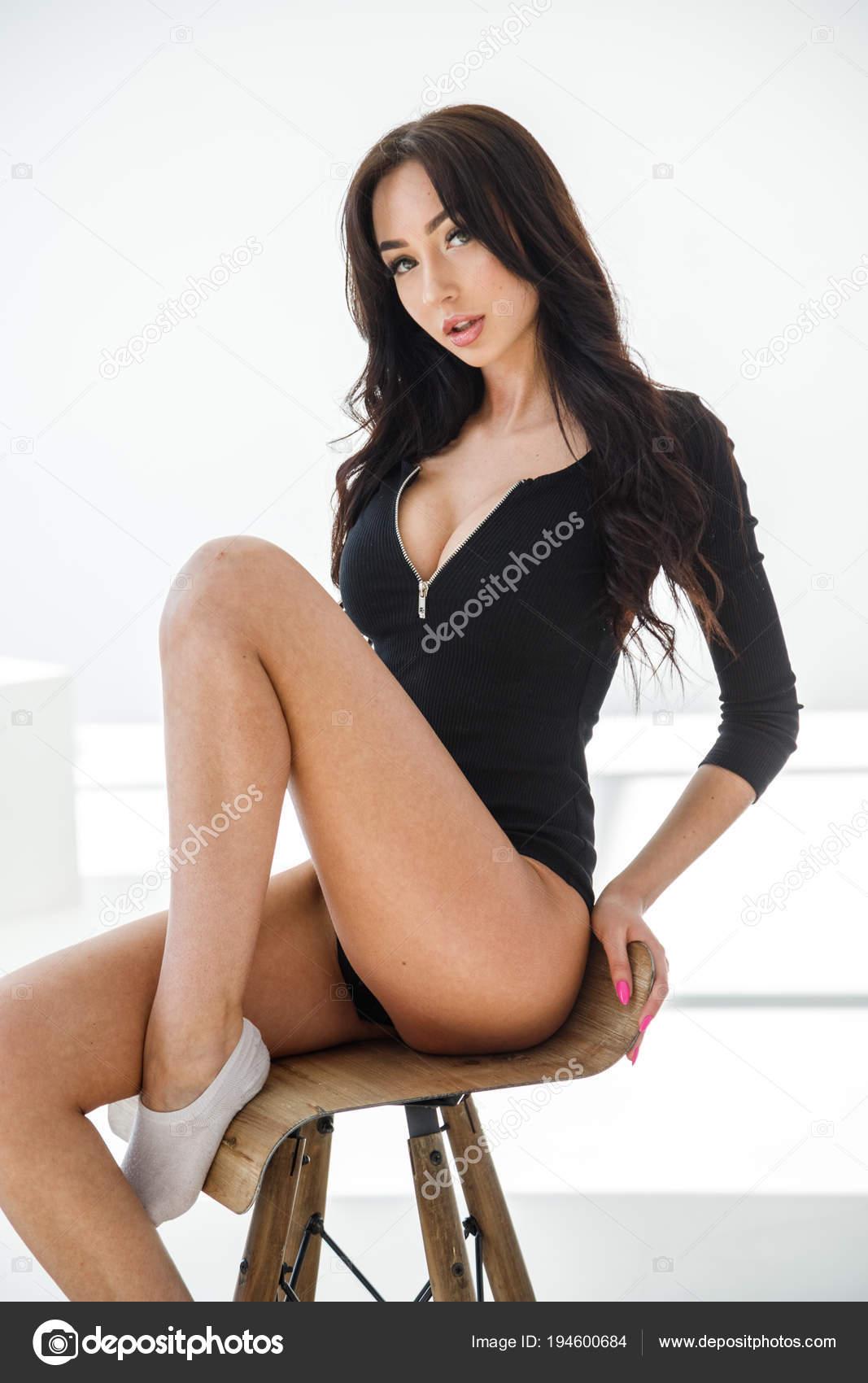 1cf1e82c0 Studio Portrait Young Brunette Girl Wearing Sexy Black Lingerie Sitting —  Stock Photo