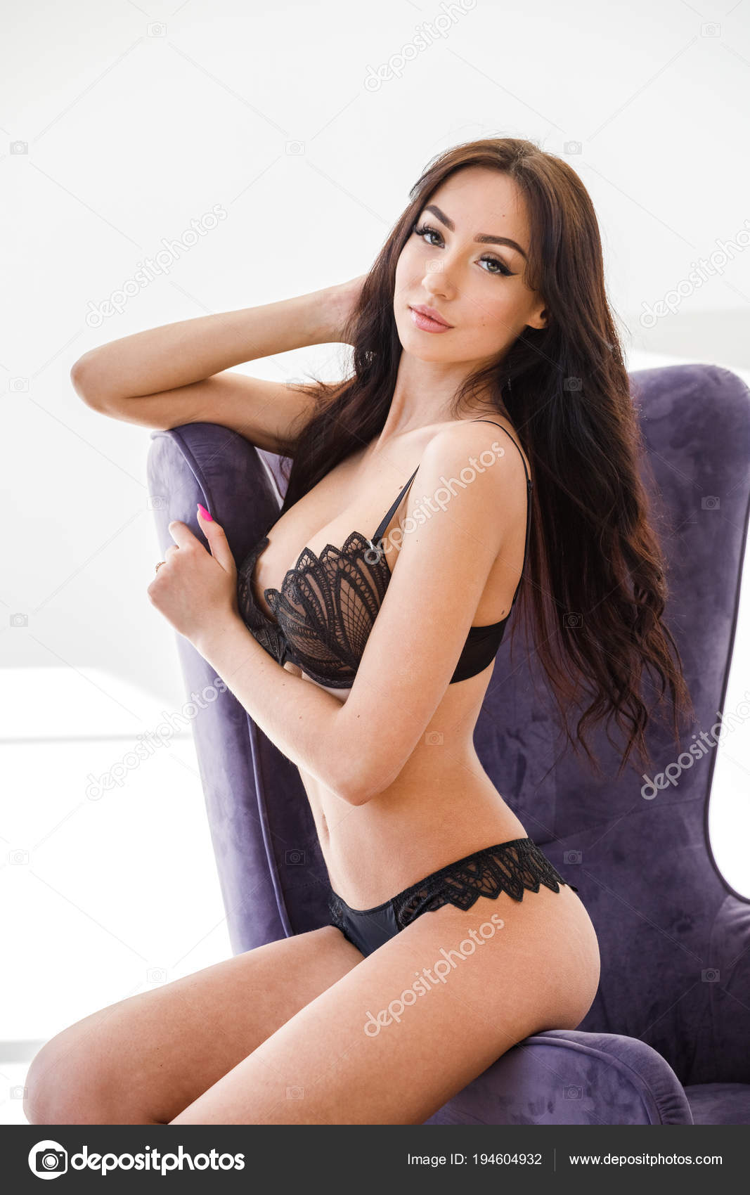 89579569e1d Studio Portrait Young Brunette Girl Wearing Sexy Black Lingerie Sitting —  Stock Photo