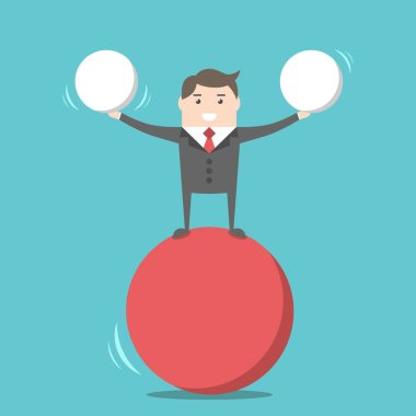 Happy businessman balancing