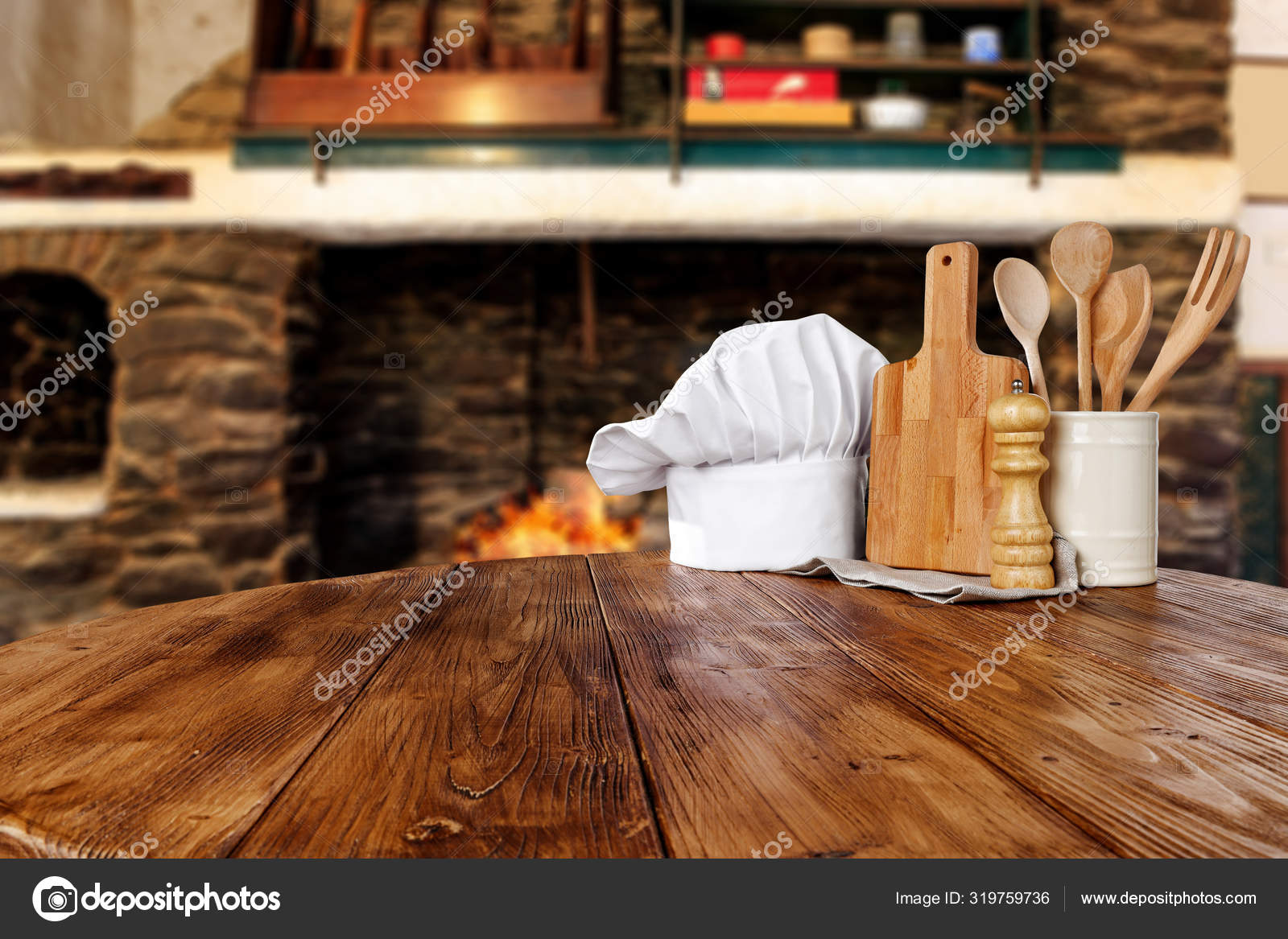 Kitchen tools on wooden table top with cosy warm home interior with old  fireplace stone wall background. Empty space for your decorations or ...
