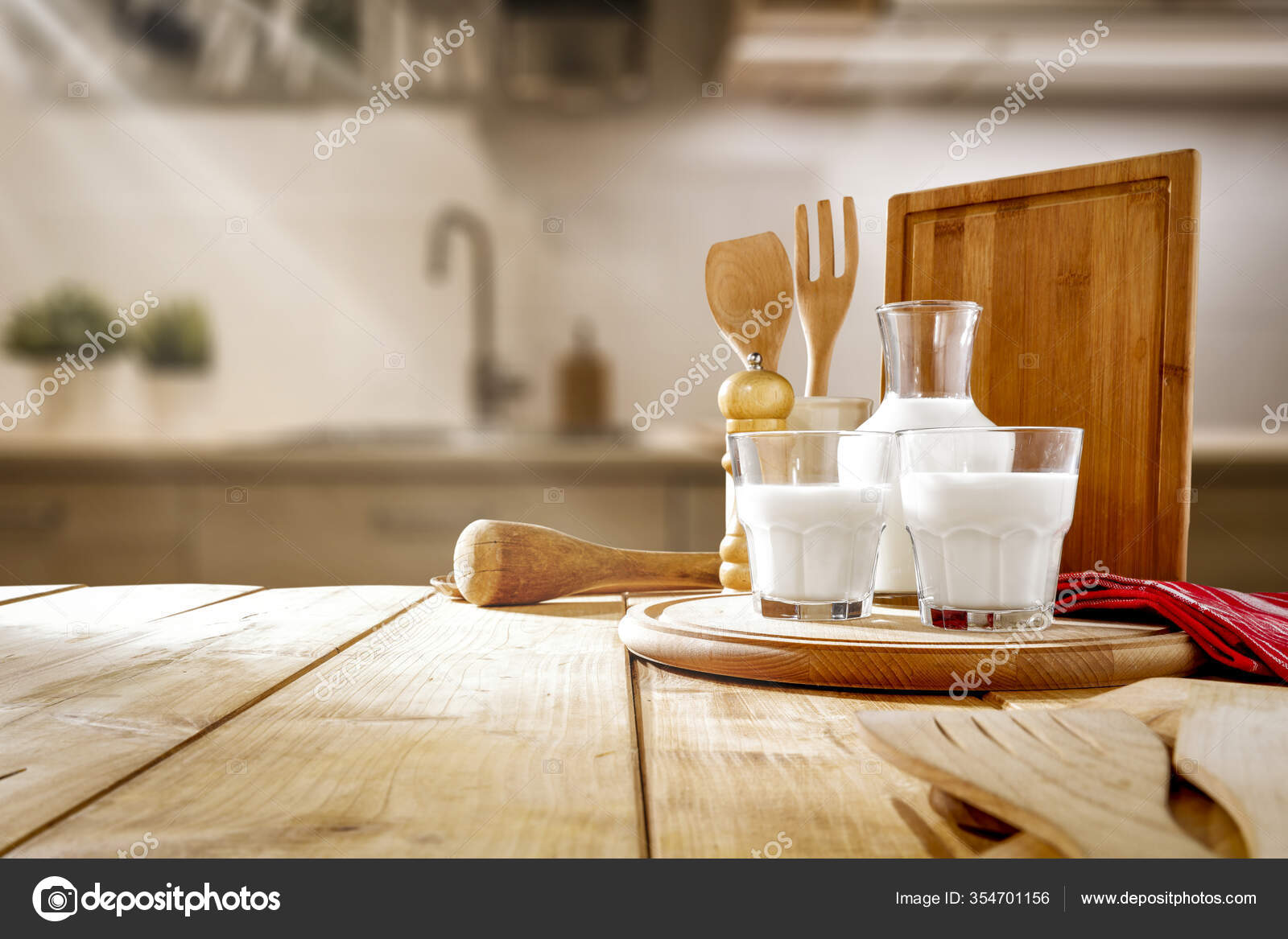 Wooden table top with kitchen background. Nice kitchen interior. 9