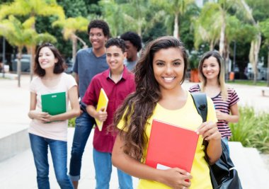 Latin american female student with group of international studen
