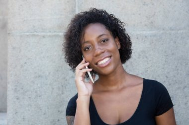 African american woman with black shirt at phone