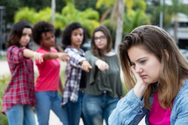 Young woman bullied by other girls