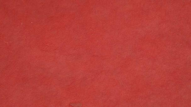 texture rotante sfondo carta colorata antica con scuro in vecchio disegno vintage angosciato. Colore della carta rosso, texture natalizia