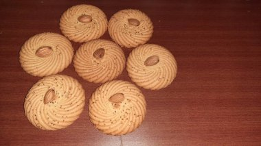 brown cookies flavored with carom seed isolated on brown background
