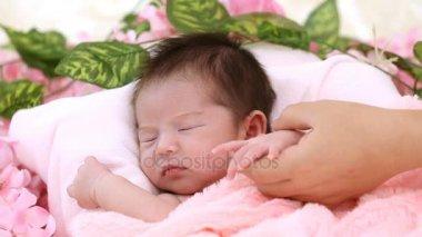 Newborn sleeping in the wood basket.