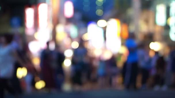 Crowds of Japanese and tourist at night walking at Takeshita street, Harajuku, Tokyo, Japan.