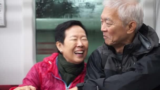 train in Asian couple