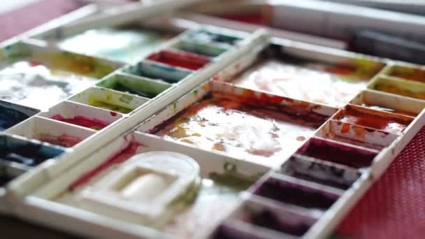 Doing art at home watercolor and painting equipments. colorful palettes and markers