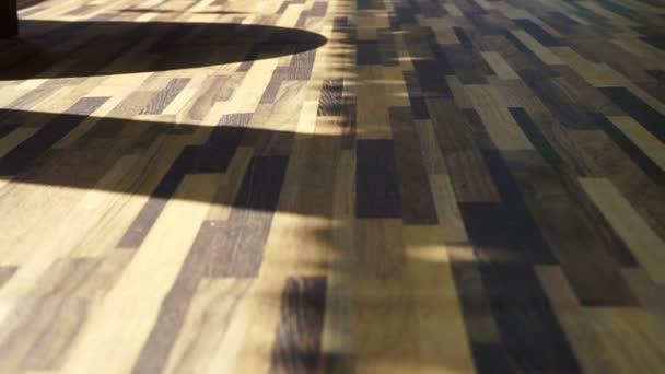 Morgensonne auf schönem Holz-Textur-Vinylboden, Interieur-Material