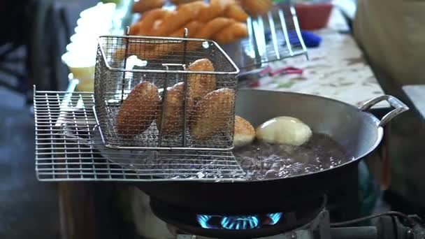Traditional Chinese food, Hands frying Doughnut, drawing oil from deep-fried dough buns.